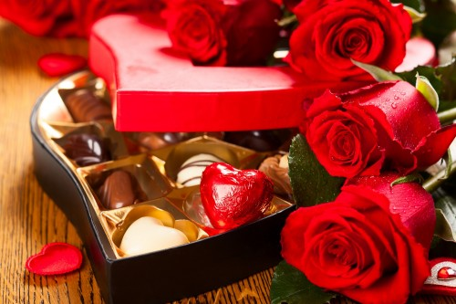 box of chocolate truffles with red roses